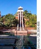 Купить «28-метровая горка аттракцион «Tower of power» в аквапарке Сиам, Коста-Адехе, Тенерифе, Канары, Испания», фото № 28304488, снято 29 декабря 2015 г. (c) Кекяляйнен Андрей / Фотобанк Лори
