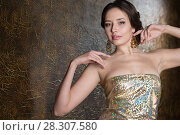 Купить «Young elegant woman in evening gold dress», фото № 28307580, снято 26 февраля 2018 г. (c) Типляшина Евгения / Фотобанк Лори
