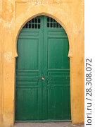 Купить «Green door to Mosque, Medina, UNESCO World Heritage Site, Essaouira, Morocco, North Africa, Africa», фото № 28308072, снято 26 марта 2017 г. (c) age Fotostock / Фотобанк Лори