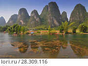 Купить «Beautiful Karst Mountain landscape with bamboo raft in Yangshuo, Guilin, China», фото № 28309116, снято 20 апреля 2018 г. (c) BE&W Photo / Фотобанк Лори