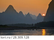 Купить «Scenic sunset over Karst mountains formations in Guilin, one of China most popular tourist destinations», фото № 28309128, снято 6 июля 2020 г. (c) BE&W Photo / Фотобанк Лори