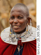 Купить «Portrait of a Maasai Woman from Kenya with Colorful African Bead Necklace Jewelry around her Neck», фото № 28309356, снято 15 июля 2018 г. (c) BE&W Photo / Фотобанк Лори