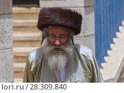 Купить «Ultra Orthodox man in Mea Shearim district, Jerusalem», фото № 28309840, снято 19 августа 2019 г. (c) BE&W Photo / Фотобанк Лори
