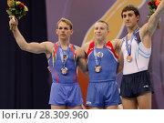 Купить «Flavius Koczi, Румыния, слева, Денис Аблязин, Россия, в центре, и Артур Давтян, Армения выиграли медали в опорном прыжке на Чемпионате Европы по спортивной гимнастике», фото № 28309960, снято 21 апреля 2013 г. (c) Stockphoto / Фотобанк Лори