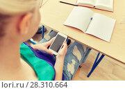Купить «student girl with smartphone texting at school», фото № 28310664, снято 22 апреля 2016 г. (c) Syda Productions / Фотобанк Лори