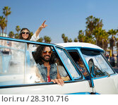 Купить «hippie friends in minivan car at venice beach», фото № 28310716, снято 27 августа 2015 г. (c) Syda Productions / Фотобанк Лори