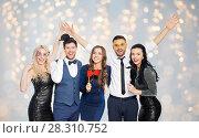 Купить «happy friends with party props posing over lights», фото № 28310752, снято 3 марта 2018 г. (c) Syda Productions / Фотобанк Лори