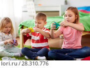 Купить «kids with modelling clay or slimes at home», фото № 28310776, снято 15 октября 2017 г. (c) Syda Productions / Фотобанк Лори