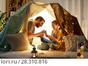 Купить «family playing tea party in kids tent at home», фото № 28310816, снято 27 января 2018 г. (c) Syda Productions / Фотобанк Лори