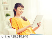 Купить «happy young asian woman with tablet pc at home», фото № 28310940, снято 9 марта 2016 г. (c) Syda Productions / Фотобанк Лори