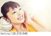 Купить «happy asian woman with earphones listening music», фото № 28310948, снято 9 марта 2016 г. (c) Syda Productions / Фотобанк Лори