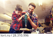 Купить «father and son with drill working at workshop», фото № 28310996, снято 14 мая 2016 г. (c) Syda Productions / Фотобанк Лори