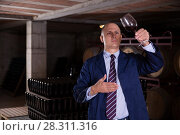 Купить «Winemaker checking red wine in wine cellar», фото № 28311316, снято 22 января 2018 г. (c) Яков Филимонов / Фотобанк Лори