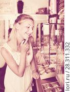 Купить «Portrait of young woman standing next to glass showcases», фото № 28311332, снято 26 марта 2019 г. (c) Яков Филимонов / Фотобанк Лори