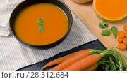 Купить «close up of vegetable pumpkin cream soup in bowl», видеоролик № 28312684, снято 8 апреля 2018 г. (c) Syda Productions / Фотобанк Лори