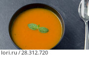 Купить «close up of vegetable pumpkin cream soup in bowl», видеоролик № 28312720, снято 8 апреля 2018 г. (c) Syda Productions / Фотобанк Лори