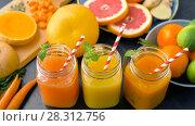 Купить «close up of fresh juices in mason jar glasses», видеоролик № 28312756, снято 8 апреля 2018 г. (c) Syda Productions / Фотобанк Лори