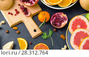 Купить «close up of fruits, nuts and vegetables on table», видеоролик № 28312764, снято 8 апреля 2018 г. (c) Syda Productions / Фотобанк Лори