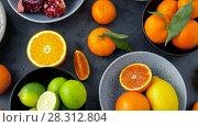 Купить «close up of citrus fruits on stone table», видеоролик № 28312804, снято 8 апреля 2018 г. (c) Syda Productions / Фотобанк Лори
