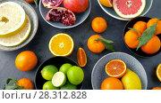 Купить «close up of citrus fruits on stone table», видеоролик № 28312828, снято 8 апреля 2018 г. (c) Syda Productions / Фотобанк Лори