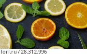 Купить «close up of grapefruit, orange, pomelo and lime», видеоролик № 28312996, снято 8 апреля 2018 г. (c) Syda Productions / Фотобанк Лори