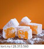 Купить «Апельсиновый рахат лукум крупным планом», фото № 28313560, снято 18 апреля 2018 г. (c) ирина реброва / Фотобанк Лори