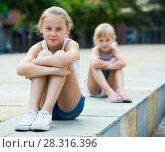Купить «Small sisters upset after quarrel outside», фото № 28316396, снято 20 июля 2017 г. (c) Яков Филимонов / Фотобанк Лори