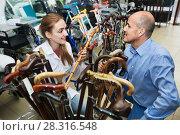 Купить «Mature man asking smiling female doctor about walking sticks», фото № 28316548, снято 20 апреля 2018 г. (c) Яков Филимонов / Фотобанк Лори