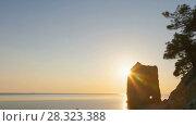 Купить «Panoramic sunset zoom out timelapse on coastline of sea with beautiful rock», видеоролик № 28323388, снято 6 июня 2017 г. (c) Кирилл Трифонов / Фотобанк Лори