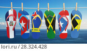 Купить «Hanging flip flops in colors of flags of different carribean countries Aruba, Bahamas, Cuba, Dominicana, Jamaica, Puerto-Rico. Travel and tourism concept.», фото № 28324428, снято 25 мая 2018 г. (c) Maksym Yemelyanov / Фотобанк Лори