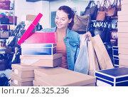 Купить «girl with carton packages in bags shop», фото № 28325236, снято 15 сентября 2016 г. (c) Яков Филимонов / Фотобанк Лори