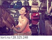 Купить «girl choosing handbag in store», фото № 28325248, снято 15 сентября 2016 г. (c) Яков Филимонов / Фотобанк Лори