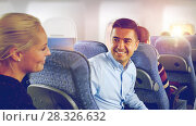 Купить «happy passengers talking in plane», фото № 28326632, снято 21 октября 2015 г. (c) Syda Productions / Фотобанк Лори