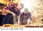 Купить «carpenters with drill drilling plank at workshop», фото № 28326716, снято 14 мая 2016 г. (c) Syda Productions / Фотобанк Лори