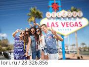 Купить «friends travelling to las vegas and taking selfie», фото № 28326856, снято 27 августа 2015 г. (c) Syda Productions / Фотобанк Лори