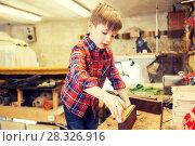 Купить «happy little boy with plank and ruler at workshop», фото № 28326916, снято 14 мая 2016 г. (c) Syda Productions / Фотобанк Лори