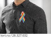Купить «man with gay pride rainbow awareness ribbon», фото № 28327032, снято 2 ноября 2017 г. (c) Syda Productions / Фотобанк Лори
