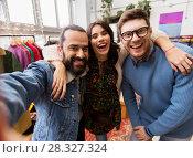 Купить «friends taking selfie at vintage clothing store», фото № 28327324, снято 30 ноября 2017 г. (c) Syda Productions / Фотобанк Лори