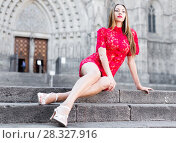 Купить «portrait of young adult girl in evening apparel sitting in european town», фото № 28327916, снято 24 июня 2017 г. (c) Яков Филимонов / Фотобанк Лори