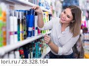 Купить «young woman choosing haircare products at store», фото № 28328164, снято 31 января 2018 г. (c) Яков Филимонов / Фотобанк Лори