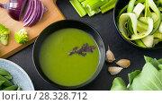 Купить «close up of vegetable green cream soup in bowl», видеоролик № 28328712, снято 14 апреля 2018 г. (c) Syda Productions / Фотобанк Лори