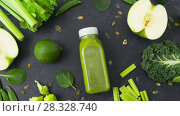 Купить «bottle with green juice and vegetables on table», видеоролик № 28328740, снято 14 апреля 2018 г. (c) Syda Productions / Фотобанк Лори