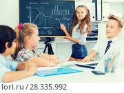 Купить «Girl discussing about mathematical formulas», фото № 28335992, снято 12 октября 2017 г. (c) Яков Филимонов / Фотобанк Лори