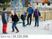 Купить «Kids skipping on chinese jumping elastic rope in yard», фото № 28335996, снято 21 июня 2018 г. (c) Яков Филимонов / Фотобанк Лори