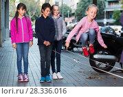 Купить «cheerful children play on street», фото № 28336016, снято 21 октября 2017 г. (c) Яков Филимонов / Фотобанк Лори