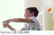 Купить «happy little boy playing with airplane toy at home», видеоролик № 28338040, снято 20 апреля 2018 г. (c) Syda Productions / Фотобанк Лори
