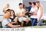 Купить «Chilling college students in classroom», фото № 28338540, снято 17 декабря 2018 г. (c) Яков Филимонов / Фотобанк Лори