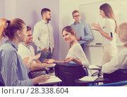 Купить «Group of students with teacher in break between lessons indoors», фото № 28338604, снято 5 октября 2017 г. (c) Яков Филимонов / Фотобанк Лори