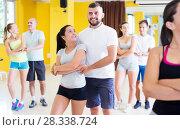 Купить «People dancing salsa in studio», фото № 28338724, снято 21 июня 2017 г. (c) Яков Филимонов / Фотобанк Лори
