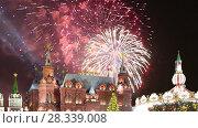 Купить «Fireworks over the State Historical Museum (inscription in Russian), near the Kremlin in Moscow, Russia (with zoom)», видеоролик № 28339008, снято 25 апреля 2018 г. (c) Владимир Журавлев / Фотобанк Лори